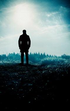 Stephen Mulcahey silhouette of a man looking towards woods Men