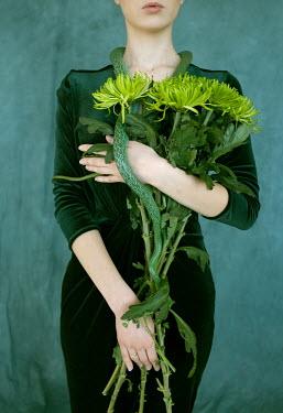 Alina Zhidovinova YOUNG WOMAN HOLDING SNAKE AND FLOWERS Women