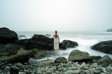 Clayton Bastiani YOUNG WOMAN BESIDE ROCKS AND MISTY SEA Women
