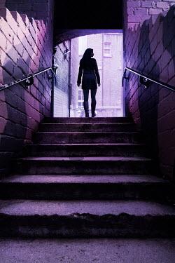 Stephen Mulcahey silhouette of a woman on alleyway steps Women