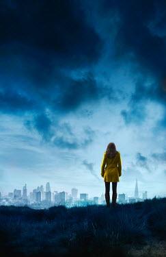 Stephen Mulcahey woman in yellow coat looking at london skyline Women