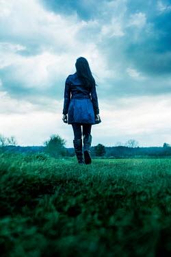 Stephen Mulcahey woman in blue coat walking in countryside Women