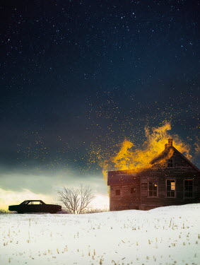 Sandra Cunningham House on fire with silhouette of a car in winter Houses