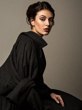 Alexey Kazantsev YOUNG BRUNETTE WOMAN WEARING BLACK COAT Women