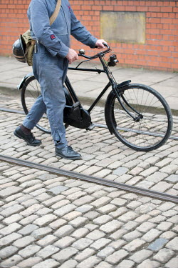 Lee Avison 1940s MAN IN OVERALLS PUSHING BICYCLE Men