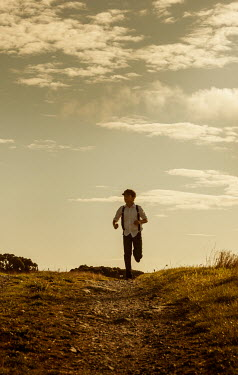 Stephen Mulcahey 1940s boy running on country road Children