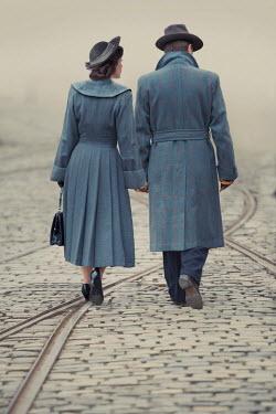 Lee Avison 1940s couple walking holding hands Couples