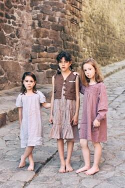 Tanya Gramatikova THREE LITTLE GIRLS ON COBBLED STREET Children