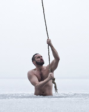 Leszek Paradowski MAN TRAPPED IN SNOW PULLING ON ROPE Men