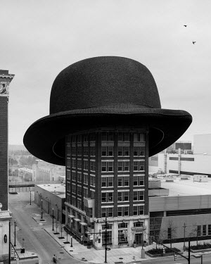 Logan Zillmer SURREAL GIANT BOWLER HAT ON CITY BUILDING Specific Cities/Towns