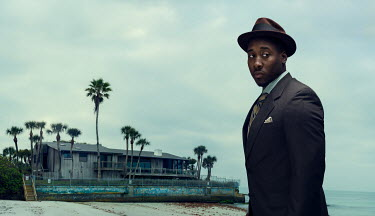 Logan Zillmer BLACK MAN IN SUIT BY SHABBY BEACH HOUSE Men