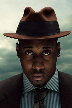 Logan Zillmer SMARTLY DRESSED BLACK MAN WEARING HAT Men