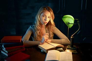 Alexander Vinogradov YOUNG BLONDE WOMAN STUDYING AT DESK Women