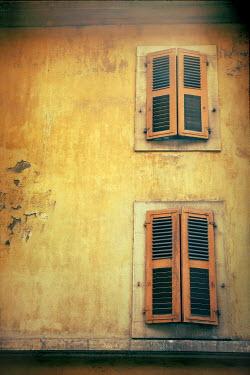 Irene Lamprakou SHABBY RUSTIC BUILDING WITH WINDOW SHUTTERS Building Detail