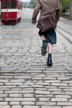 Lee Avison 1940s boy chasing a tram Children
