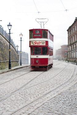 Lee Avison 1940s red tram on urban cobbled street Miscellaneous Transport
