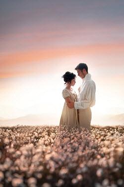 Lee Avison romantic regency couple in field at sunset Couples