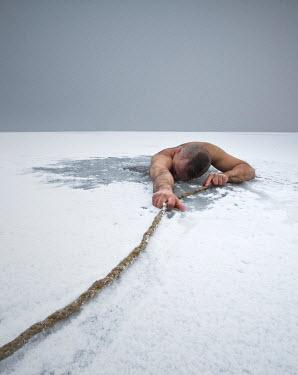 Leszek Paradowski MAN STUCK IN SNOW PULLING ON ROPE Men