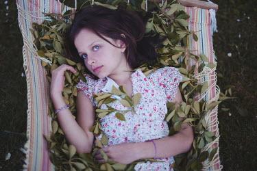 Anna Rakhvalova YOUNG BRUNETTE GIRL LYING IN HAMMOCK Children
