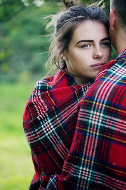 Rekha Garton YOUNG COUPLE WRAPPED IN BLANKET Couples