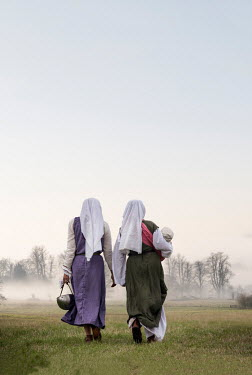 Stephen Mulcahey Two medieval women walking through countryside Groups/Crowds
