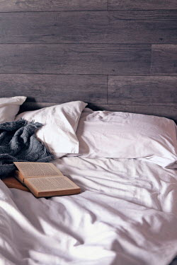 Isabelle Lafrance OPEN BOOK ON MESSY BED Interiors/Rooms