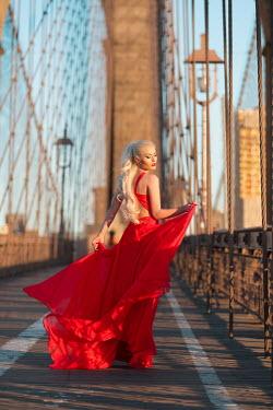 Dan Tidswell GLAMOROUS BLONDE WOMAN WALKING ON BRIDGE Women