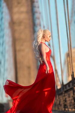 Dan Tidswell GLAMOROUS BLONDE WOMAN ON BRIDGE Women