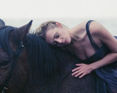 Dan Tidswell BLONDE WOMAN RESTING HEAD ON HORSE Women
