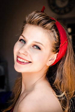 Elly De Vries YOUNG BLONDE WOMAN WEARING RED HEADBAND Women