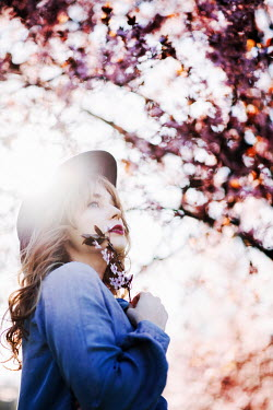Muna Nazak YOUNG WOMAN IN HAT BY PINK BLOSSOM TREES Women