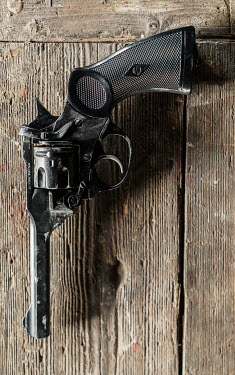CollaborationJS vintage webley pistol on wooden table Weapons
