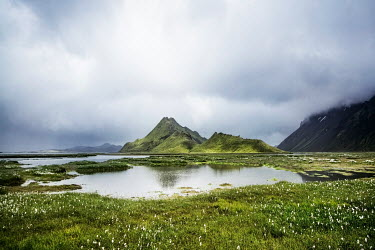 Evelina Kremsdorf GREEN MOUNTAIN BY LAKE IN COUNTRYSIDE Rocks/Mountains