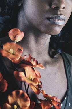 Magdalena Russocka YOUNG BLACK WOMAN WITH ORANGE FLOWERS Women