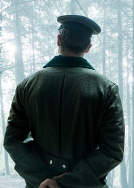 CollaborationJS 1940s officer looks into a forest Men