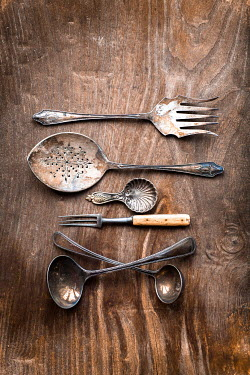 Jan Bickerton Vintage cutlery on wooden background. Miscellaneous Objects