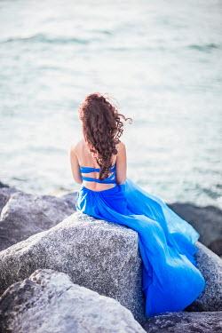 Evelina Kremsdorf WOMAN IN BLUE DRESS SITTING BY SEA Women