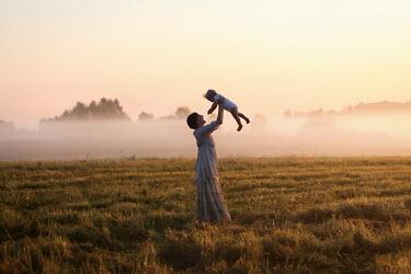 Efim Shevchenko WOMAN WITH BABY IN MISTY FIELD Women