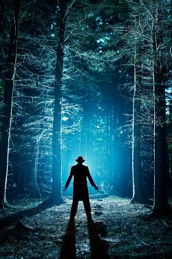John Herbert Harrison SILHOUETTE OF MAN WEARING HAT IN FOREST Men