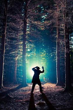 John Herbert Harrison SILHOUETTE OF MAN WITH HANDS UP IN FOREST Men