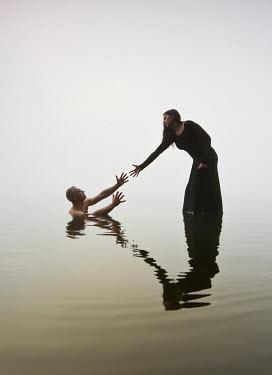 Leszek Paradowski WOMAN REACHING TO DROWNING MAN IN LAKE Couples