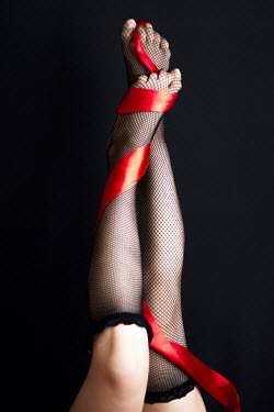 Nilufer Barin WOMANS LEGS IN FISHNET STOCKINGS AND RIBBON Body Detail