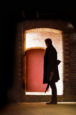 CollaborationJS silhouette of man with shotgun in warehouse Men