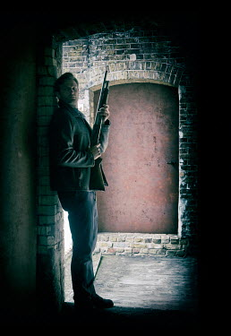 CollaborationJS man with shotgun in shadowy warehouse Men