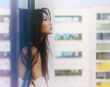 Vanessa Ho YOUNG ASIAN WOMAN LOOKING OUT BALCONY WINDOW Women