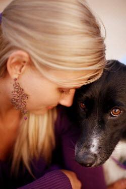 Robert Swiderski YOUNG BLONDE WOMAN WITH DOG Women
