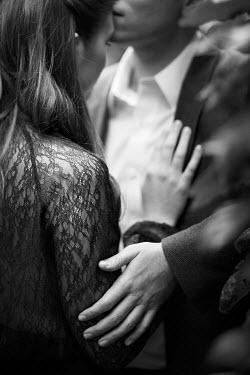 Robert Swiderski YOUNG GLAMOROUS COUPLE EMBRACING Couples