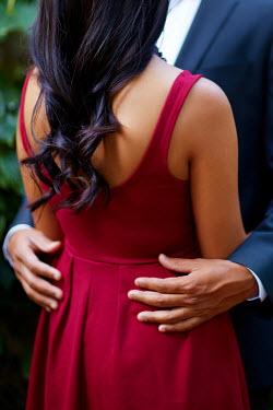 Robert Swiderski YOUNG COUPLE EMBRACING Couples