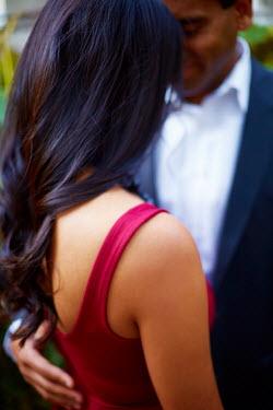 Robert Swiderski YOUNG MULTI-ETHNIC COUPLE EMBRACING Couples