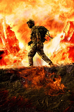 Nik Keevil SOLDIER WALKING THROUGH FIRE IN WAR ZONE Men